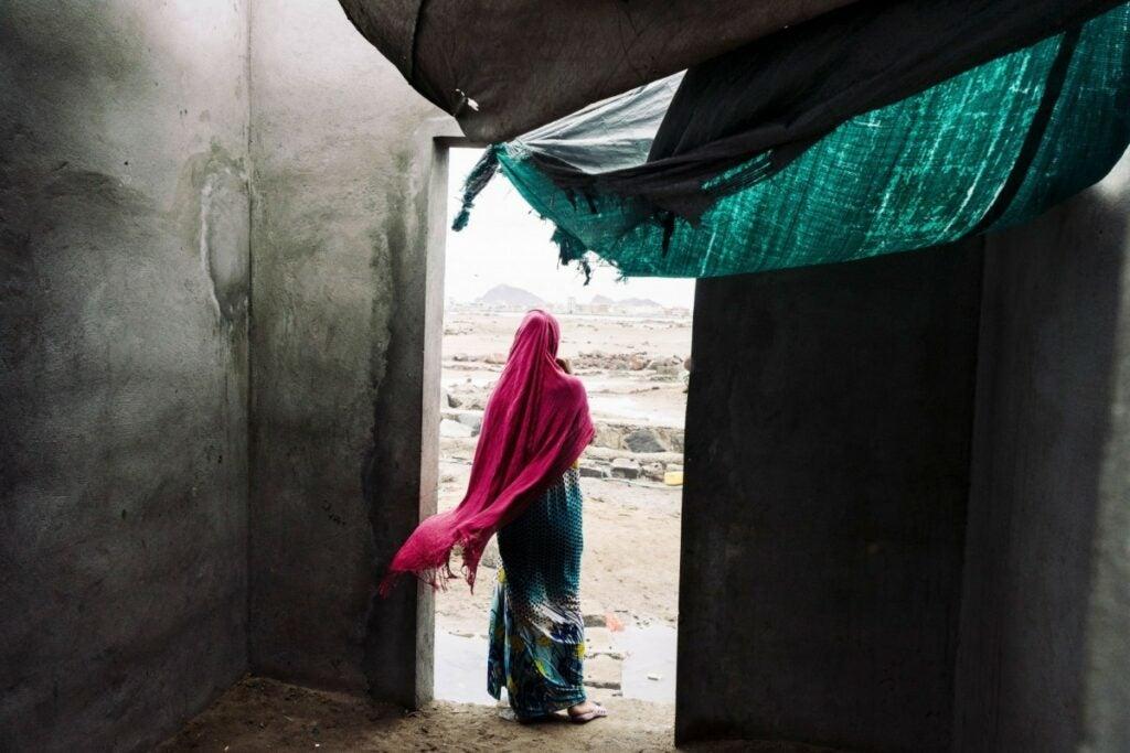 woman in pink head covering in Yemen