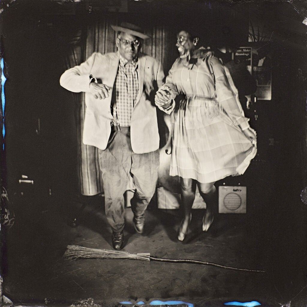 Dom Flemons and Vania Kinard holding hands