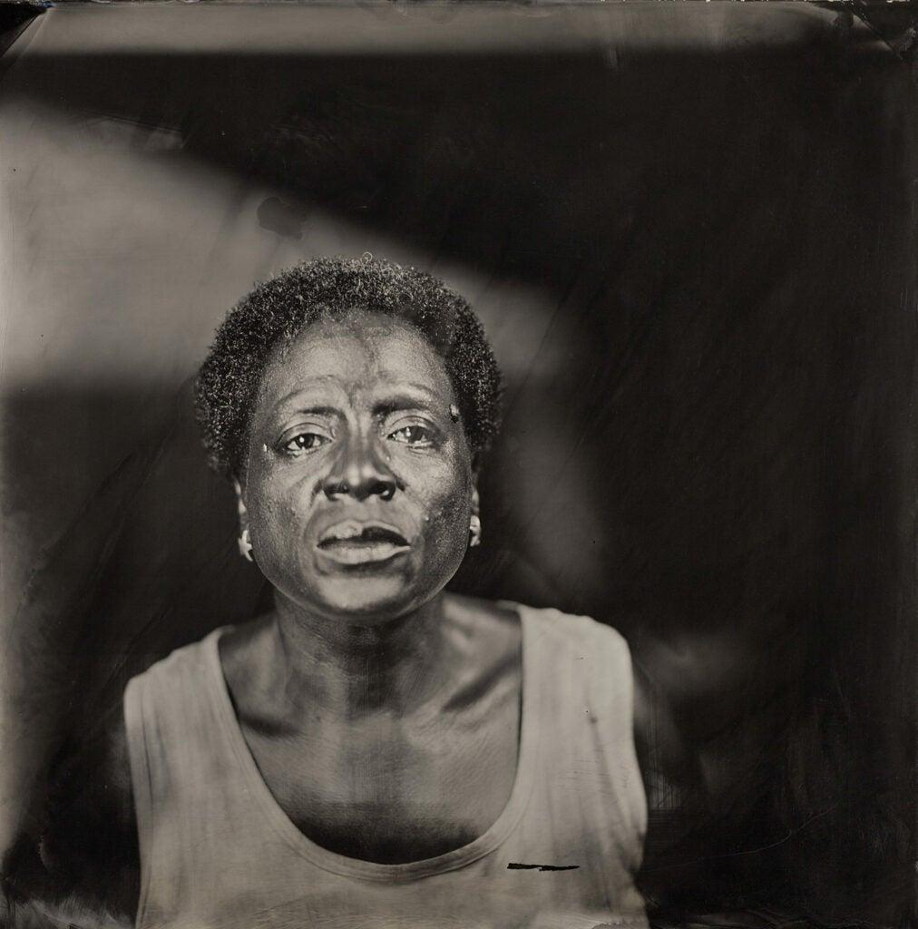 Sharon Jones with solemn face