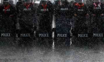 Photo of the Day: Thai Police Take Position in Torrential Downpours