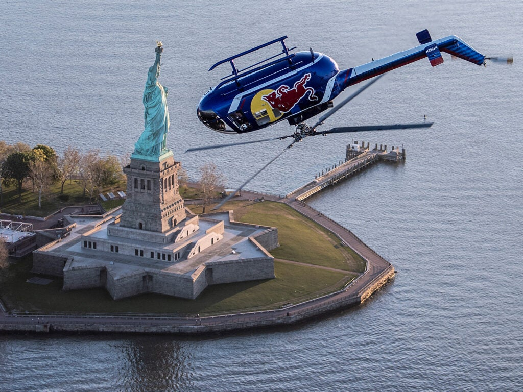 Redbull helicopter upside down over Statue of Liberty