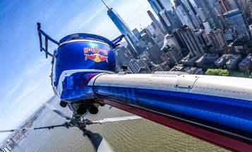 Daring photos of the Red Bull aerobatic helicopter over the New York harbor