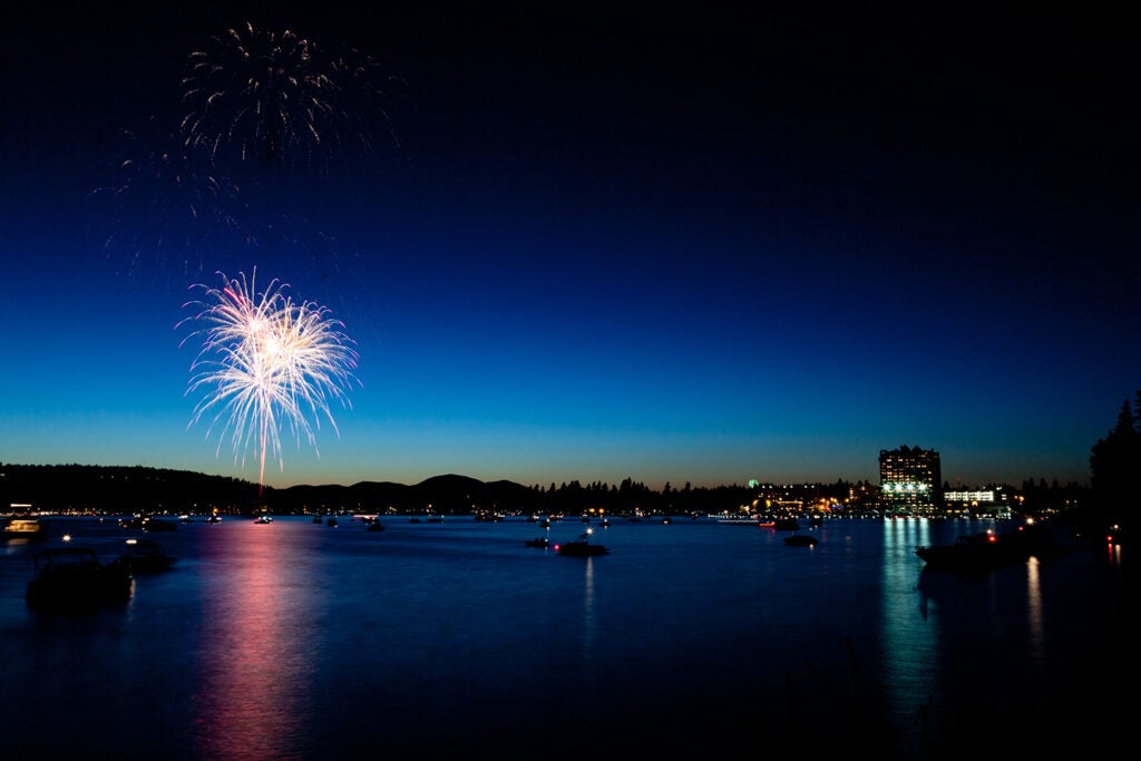 Fireworks over the lake at night
