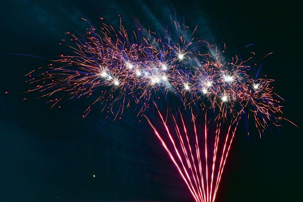 red firework against night sky