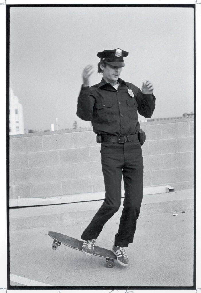 skateboarding policeman