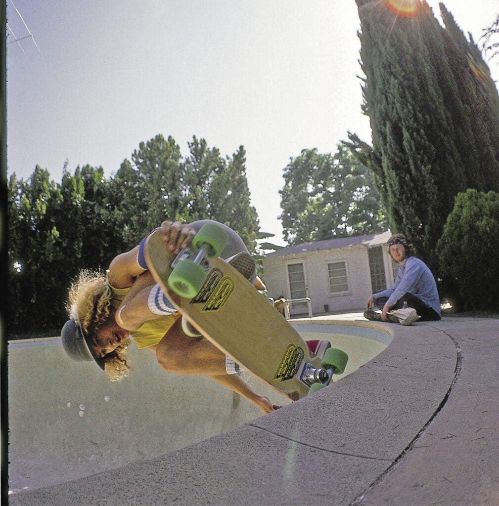 skateboarder in dog bowl