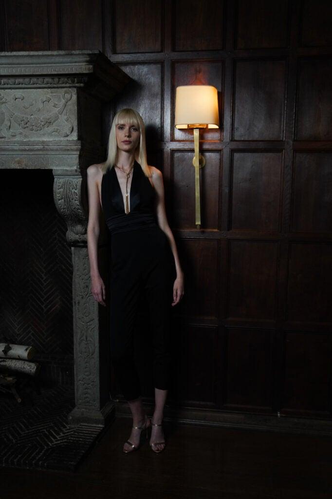 blonde woman in black dress in dim light