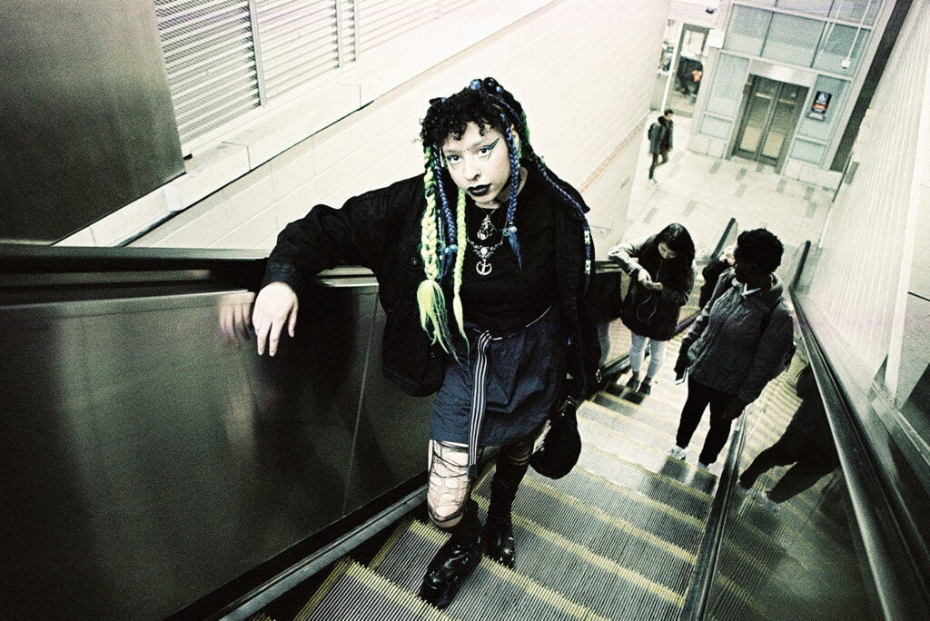 girl ascending escalator