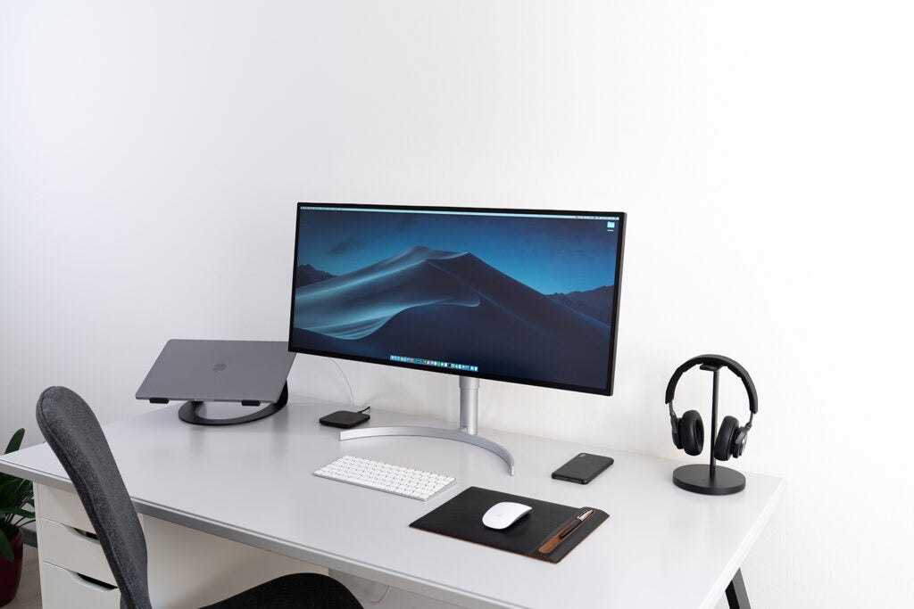 photo editing monitor on white desk