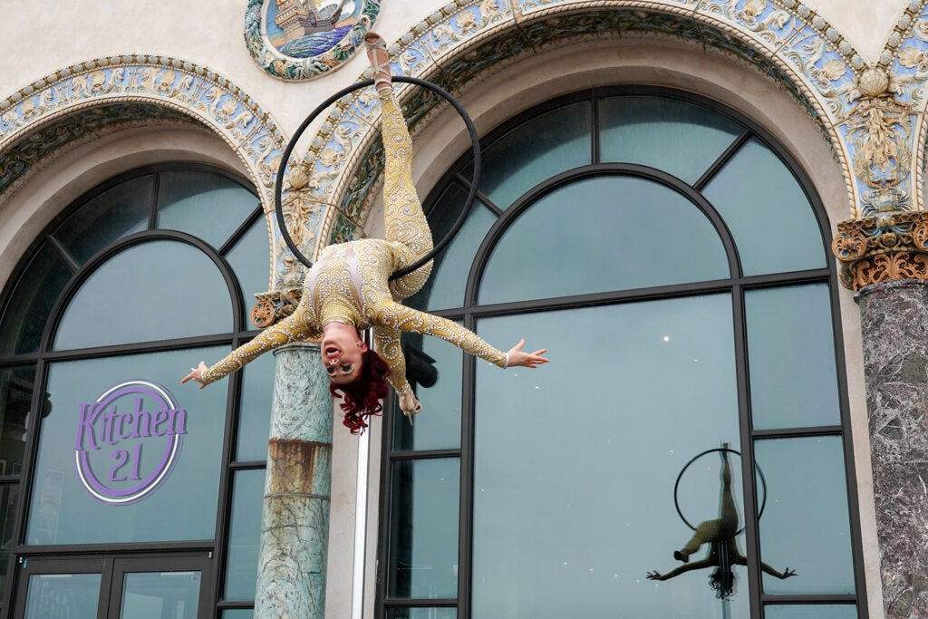 performer hanging from ring