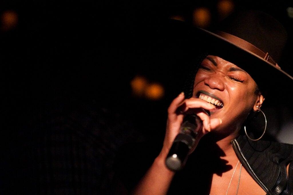 singer closing eyes while singing