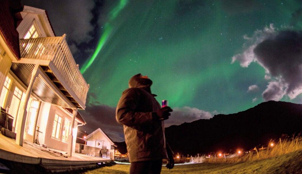 Trevor Moran beneath the Northern Lights