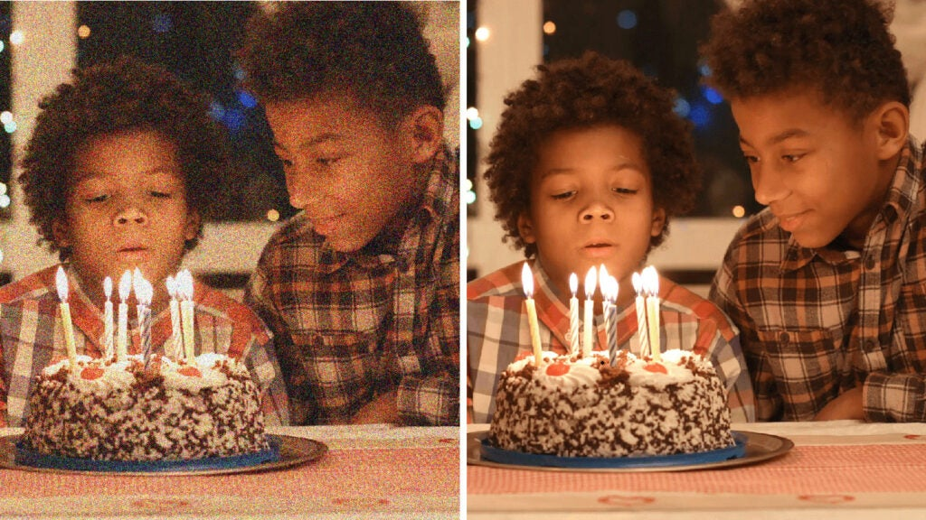graininess reduced on photo of kids blowing out birthday candles