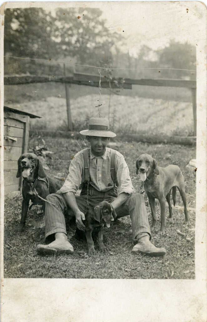 Vintage photo of man with his hounds