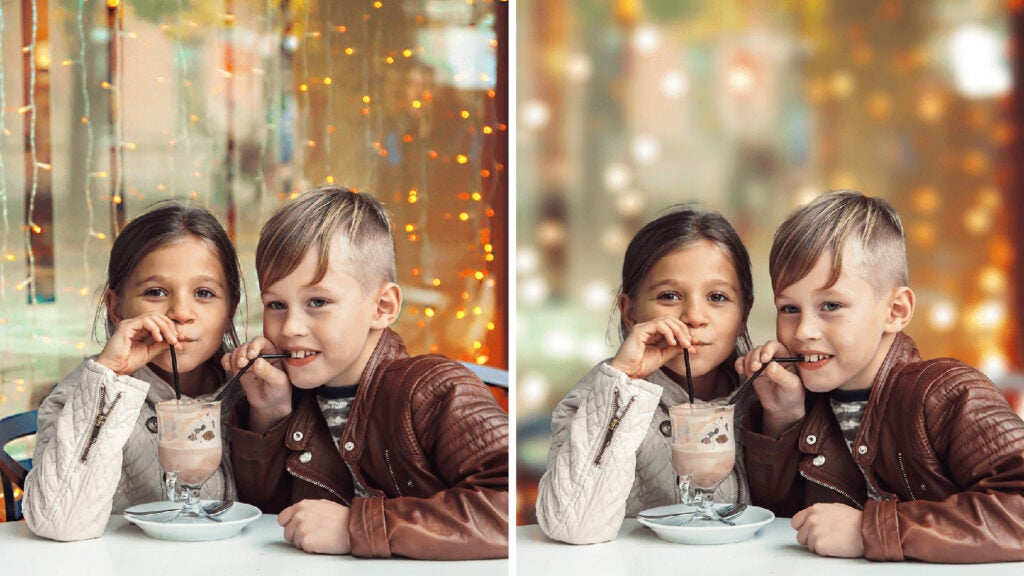 girl and boy sharing a milkshake with two straws