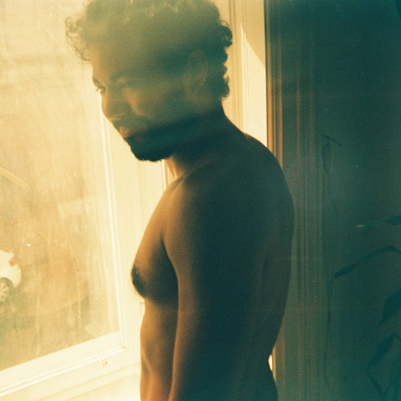 shirtless man by the window