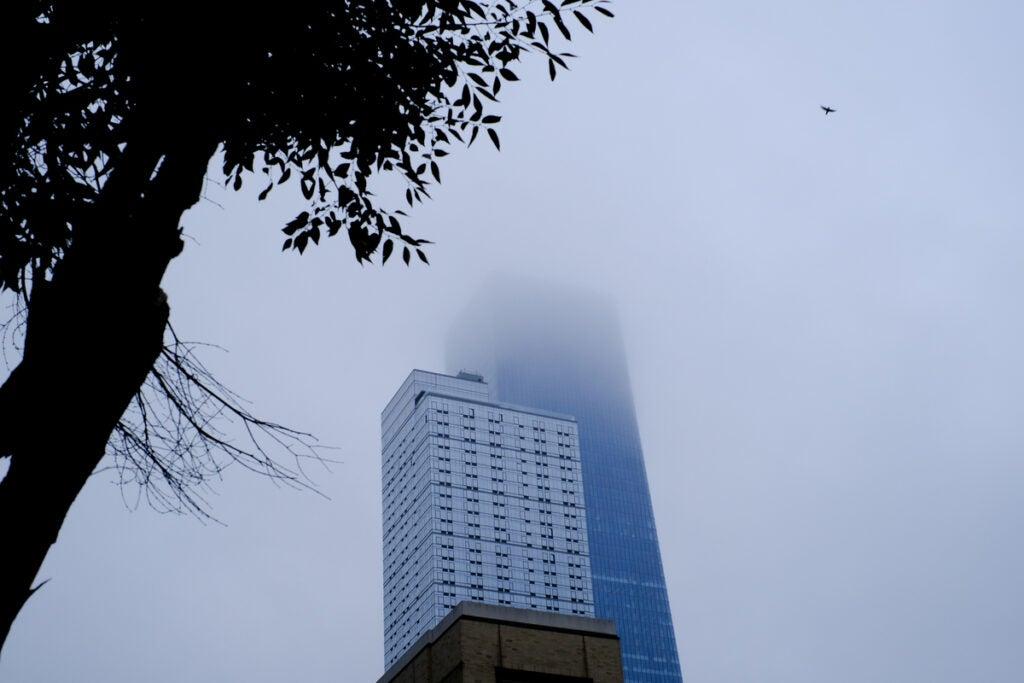 skyscraper clouded in fog