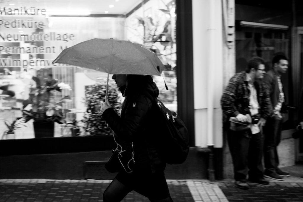 black and white pedestrian with umbrella