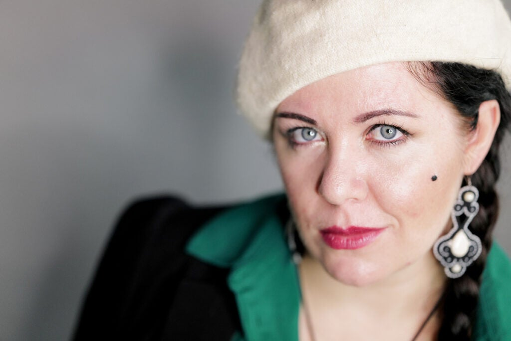 woman with white hat and green lapel