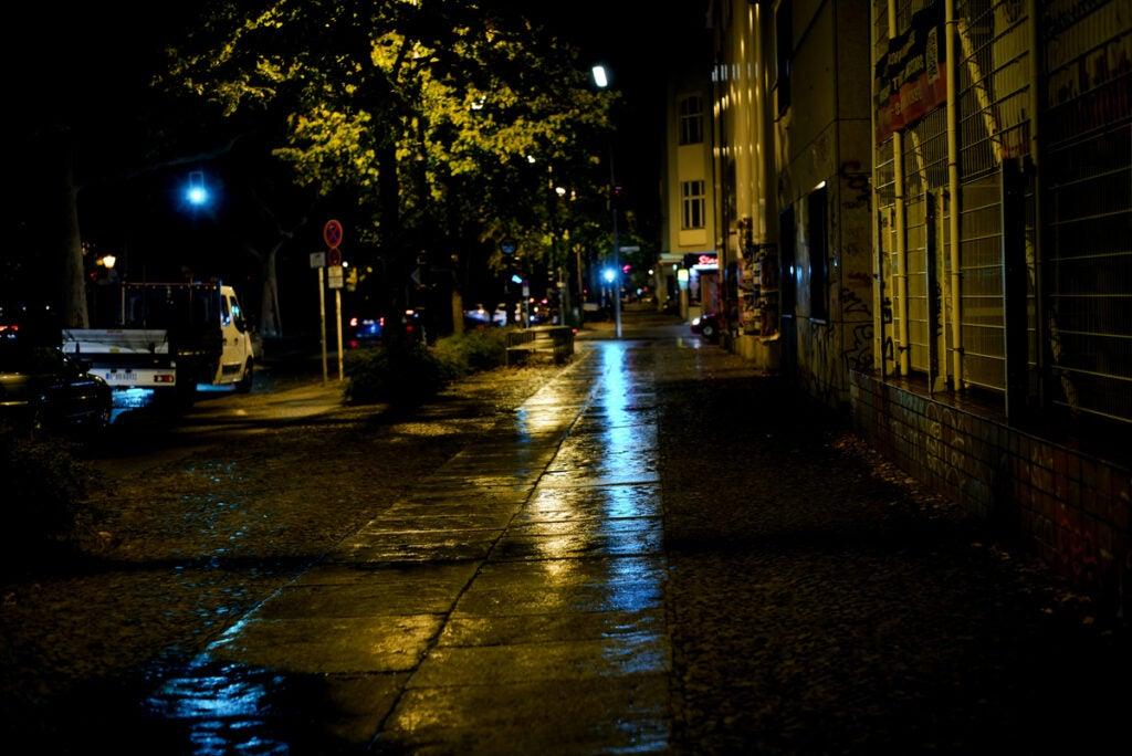 wet sidewalks at night