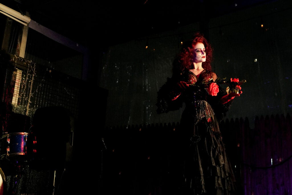 woman in black dress with red hair