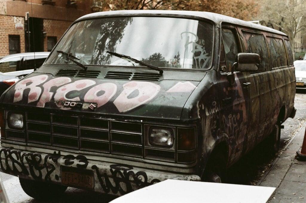 black van covered in graffiti