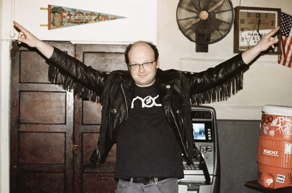 Man in black leather jacket with fringe