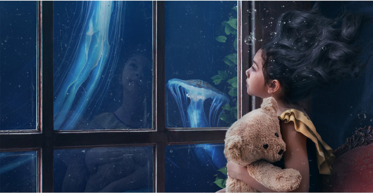 photo manipulation of little girl with floating hair with the ocean outside the window