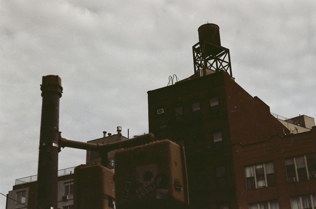 Watertower against a muted sky in New York.