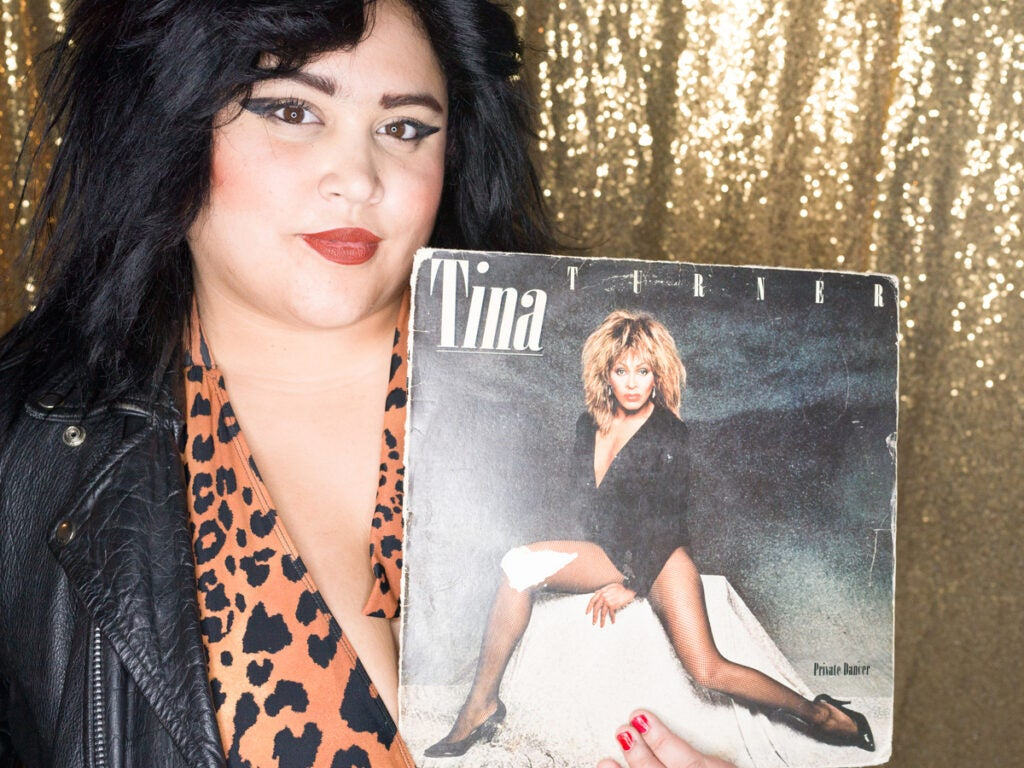 Woman in leopard print with Tina Turner album