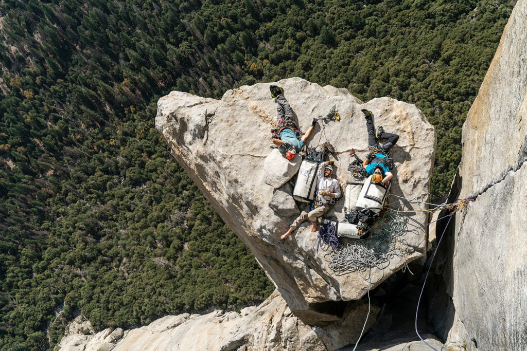 climbers napping on a cliff by Salathé Wall