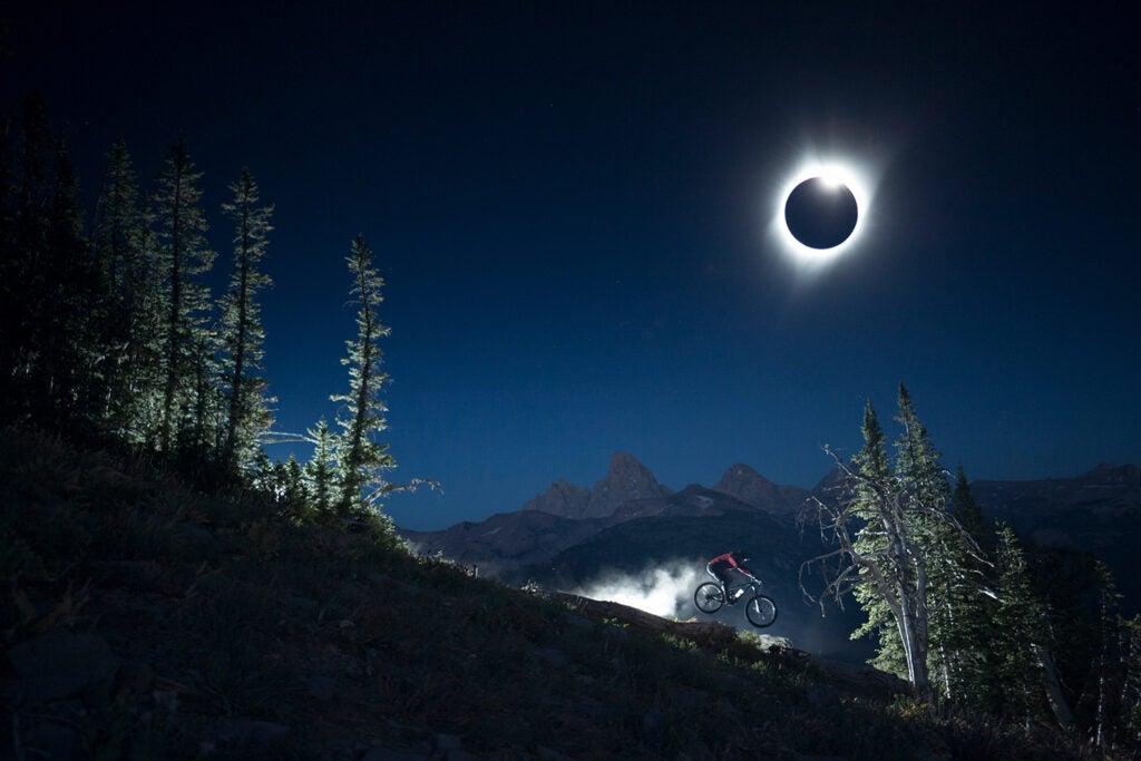 Chris Bule riding under the Total Solar Eclipse