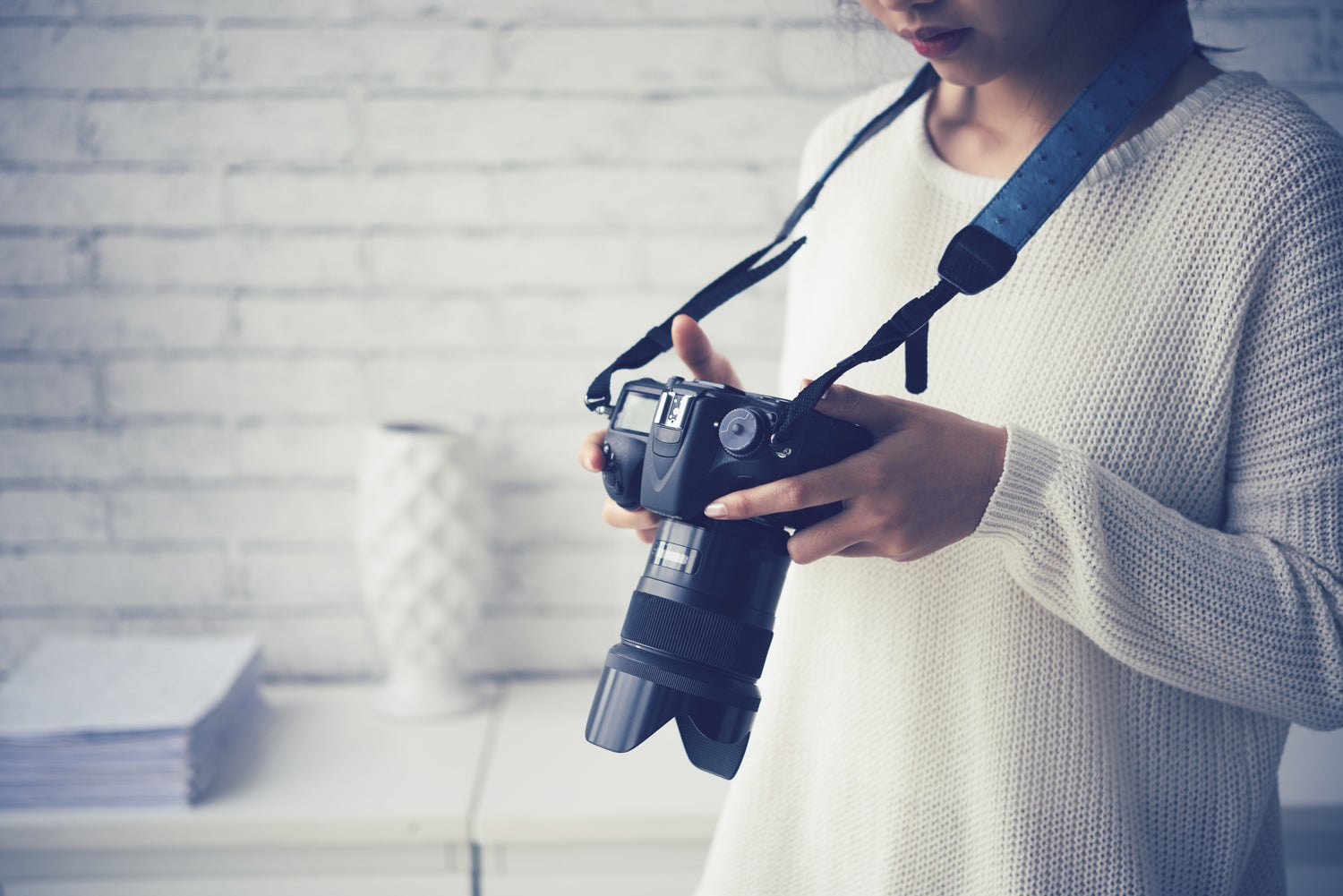 Female photographer checking photos in her camera