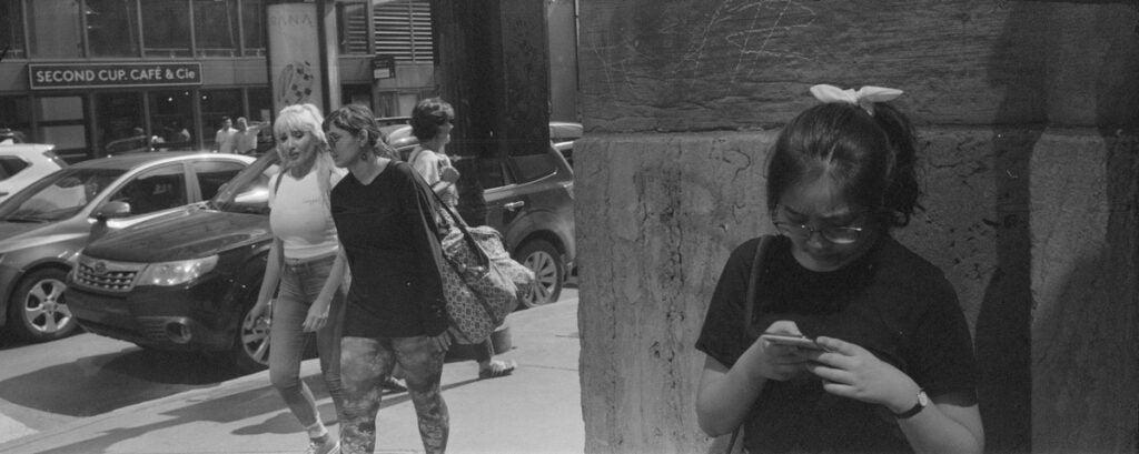 pedestrian looking at phone