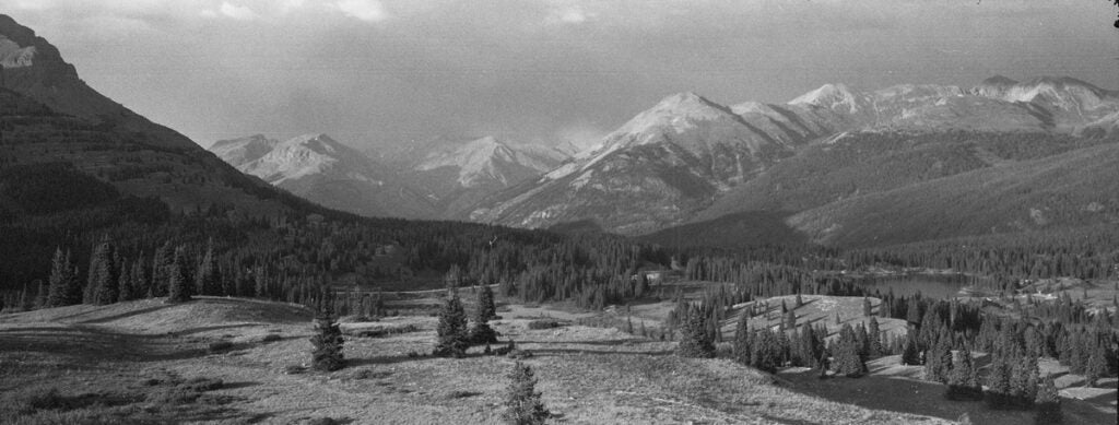 panoramic image of mountains in black and white