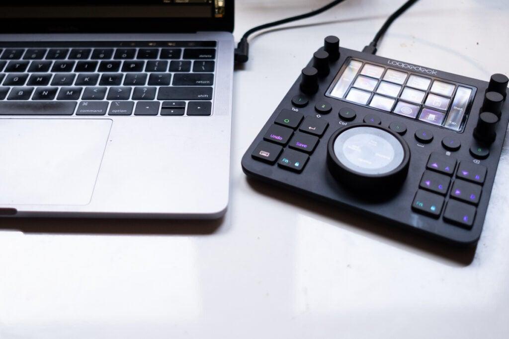 Loupedeck creative tool next to laptop