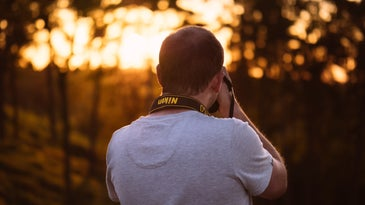 Person shooting photo at sunset.