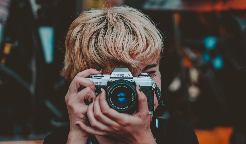 Person holding a film camera