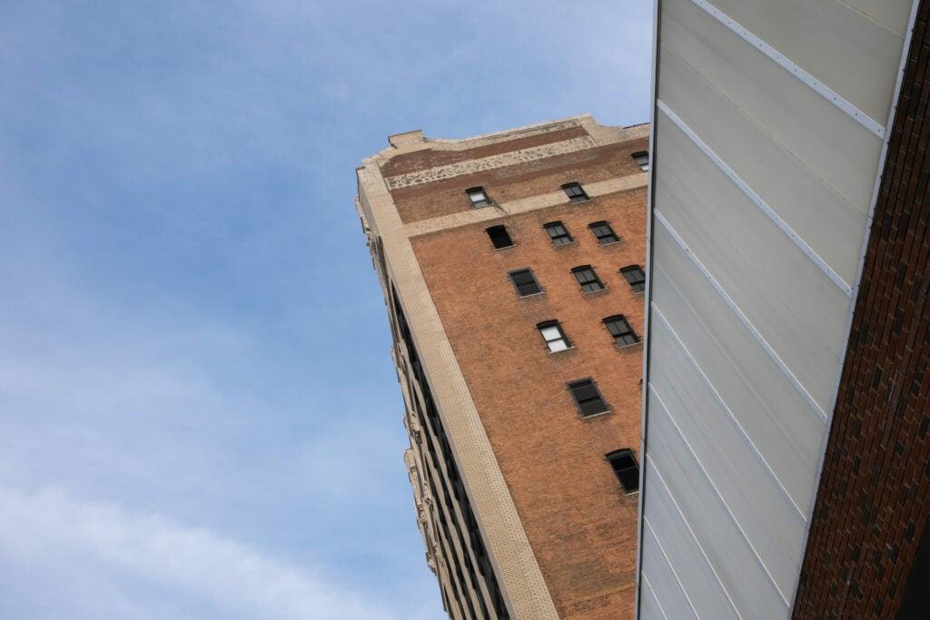 Tall brick building from below