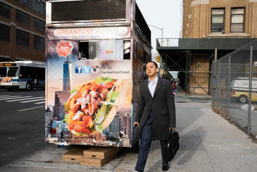 Pedestrian passing a food truck