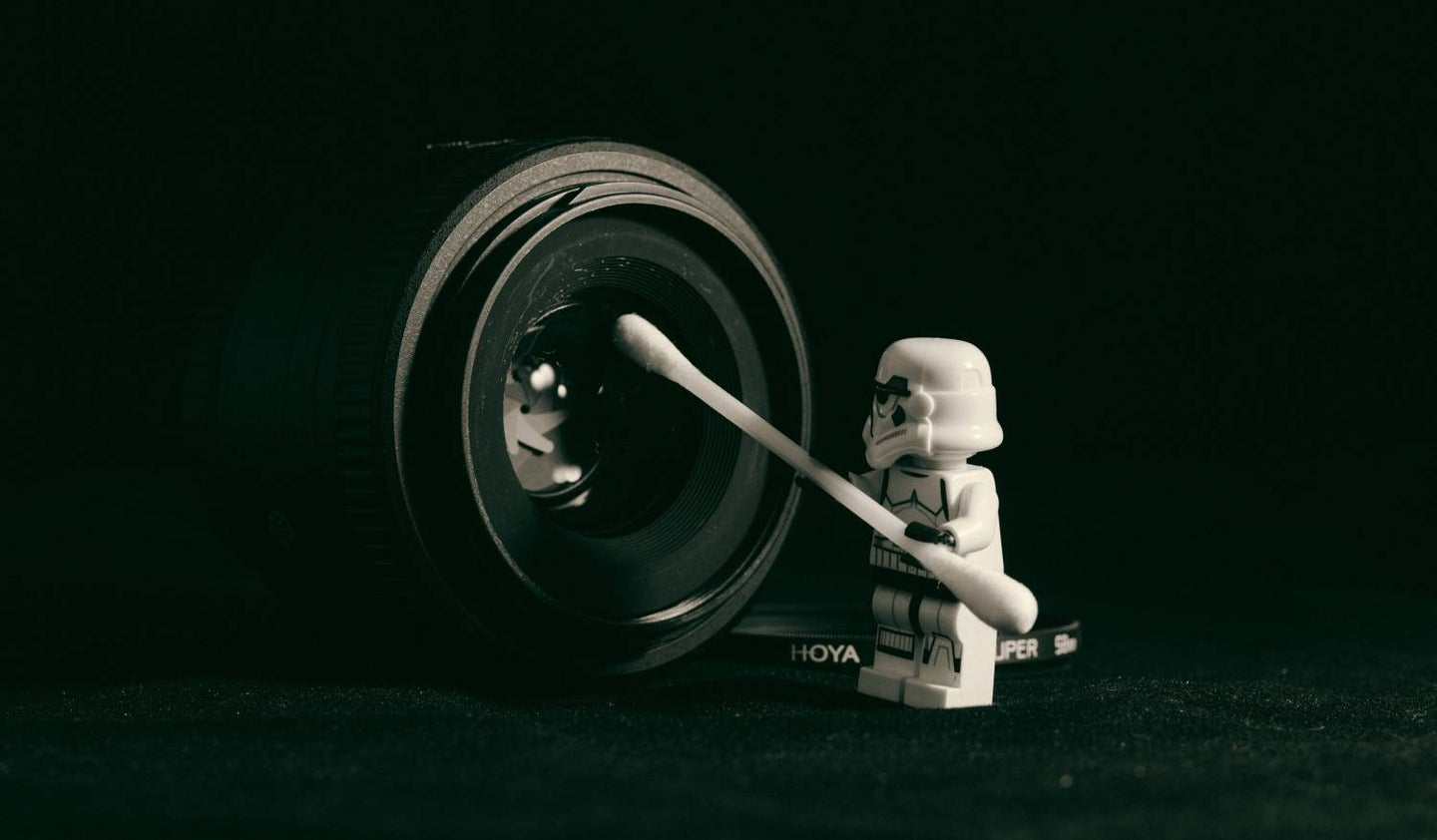 Star Wars Lego figurine cleaning camera lens