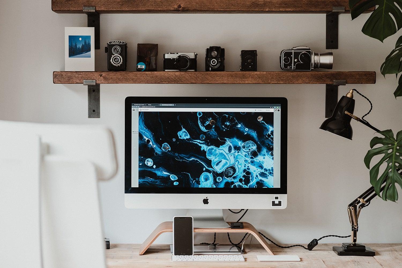 An iMac on a computer desk.