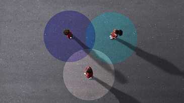 people standing on three intersecting colored circles