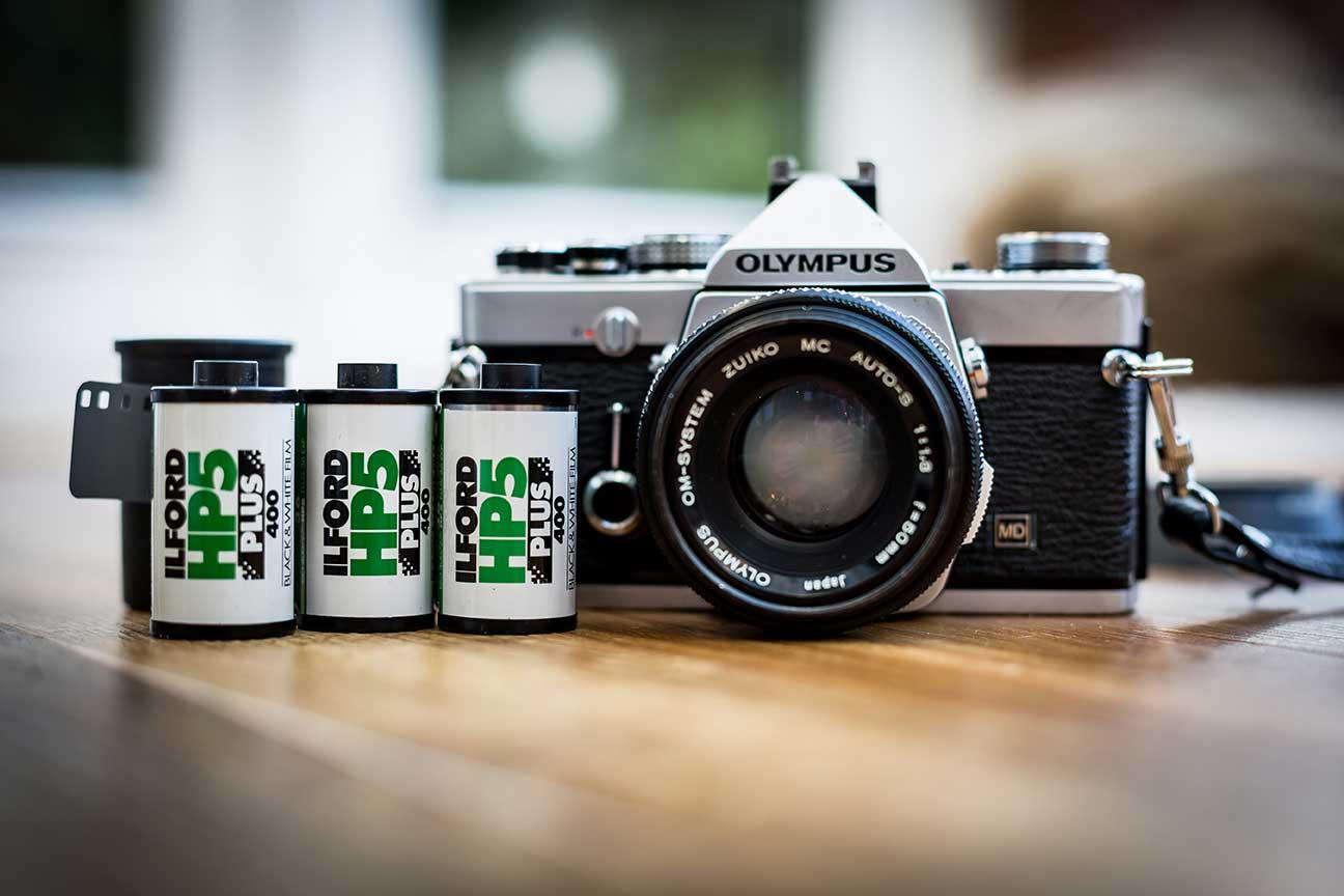 Ilford film next to an Olympus camera