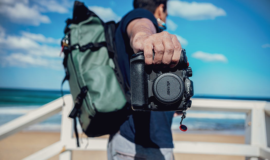person holding a camera with a backup