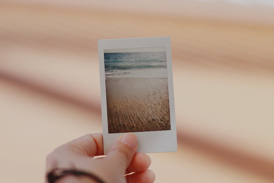 person holding an instant camera print
