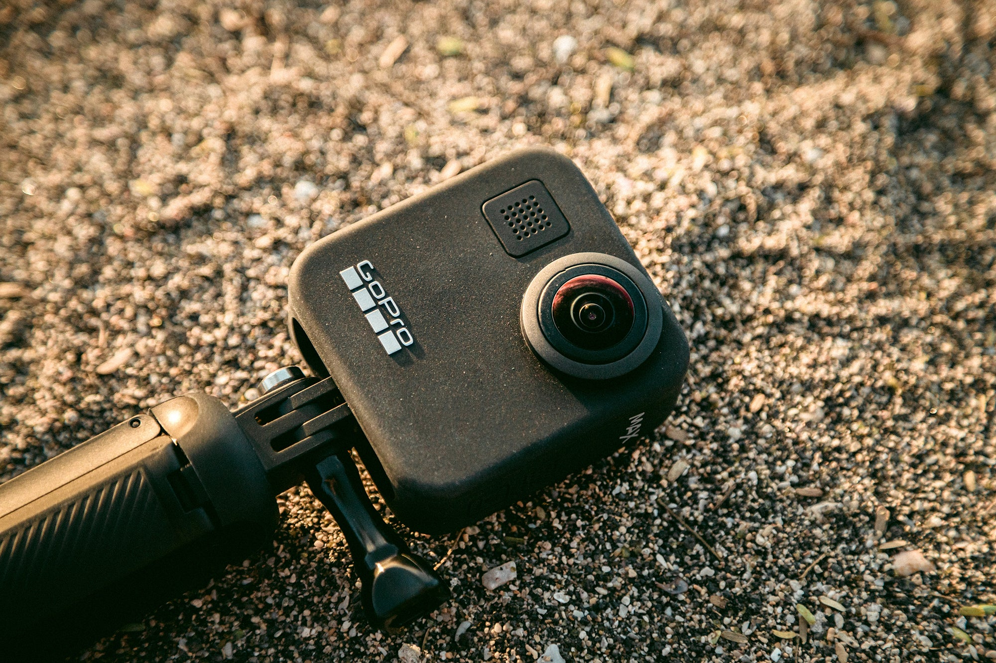gopro 360 action camera on course sand