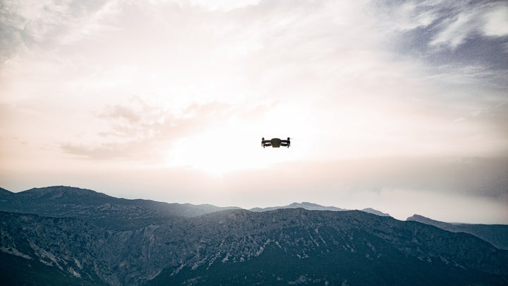 drone flying above the mountains in the sky