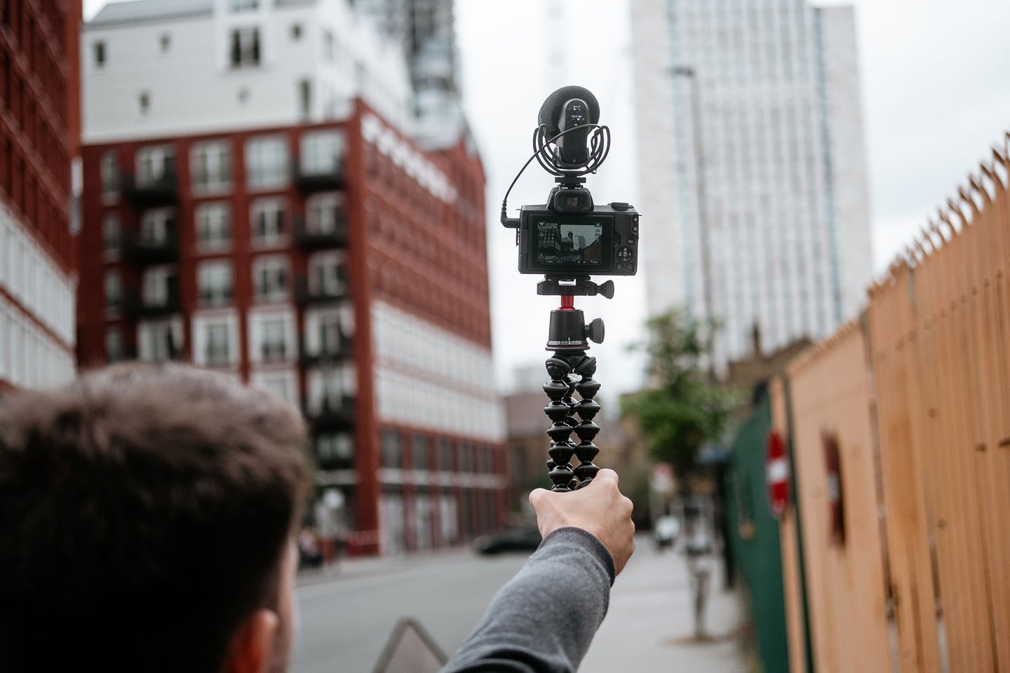 Guy holding a tripod for selfie