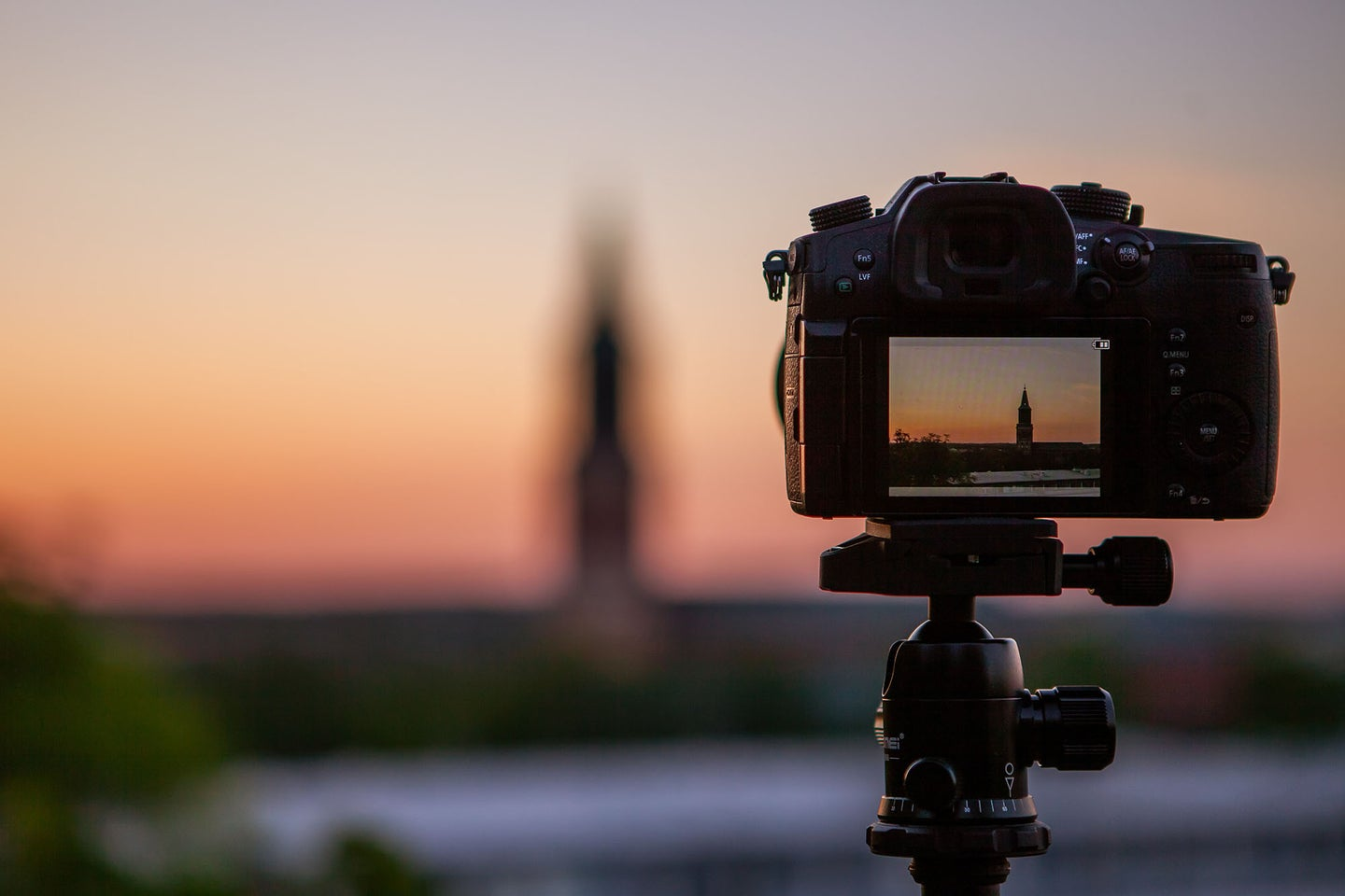 camera on a tripod facing a sunset using the best micro SD card
